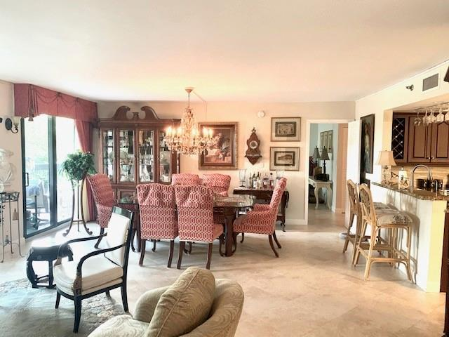 This is the most sought after floor plan. You will be amazed at the open space to the kitchen and with 2 hurricane impact sliders that enter the 38' covered pie shape balcony.  Great for entertaining or just to enjoy more living space. Chandelier doe