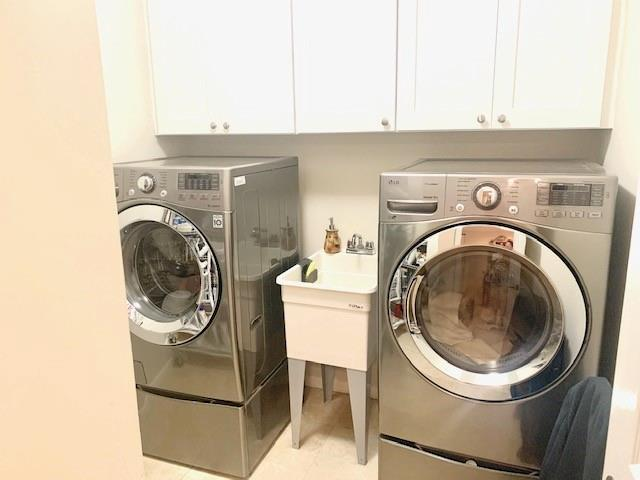Amazing laundry room with sink and lots of storage.