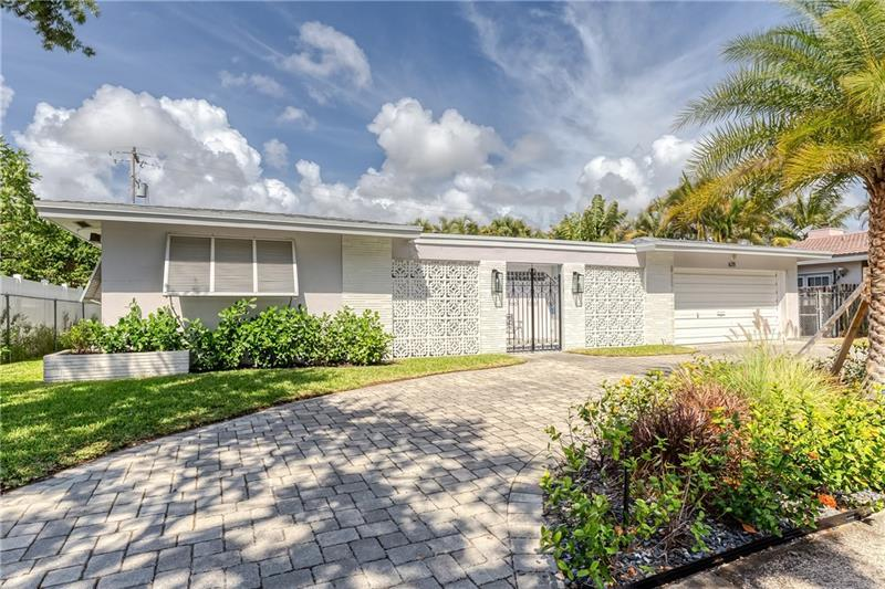 Great opportunity in Imperial Point. Large 3 bedroom, 2 bathroom home with a full 2 car garage & air conditioned laundry room in the heart of Fort Lauderdale. This home features a great layout with a family room, dining area, and eat in kitchen. Renovate & open up the spacious kitchen for an open floor plan. Home has a large indoor laundry room with great space for additional storage. Oversized covered patio offers great opportunity to enclose it to increase square footage of the home. The neighborhood is quite and close to the beach, shopping and great dining! The home is a clean slate & ready for your personal design touches. A new roof was installed in March of 2021, fenced yard, sprinklers, yard, circular pavered driveway, and so much m