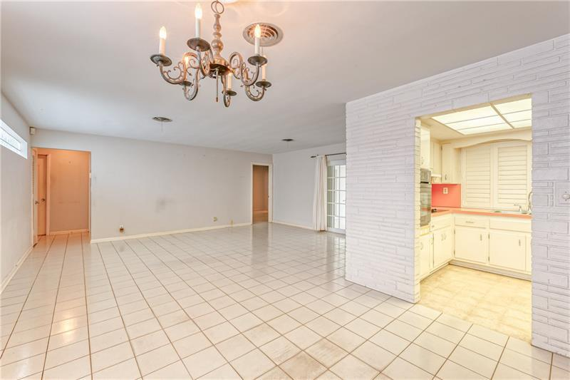Main living space is spacious with tile flooring