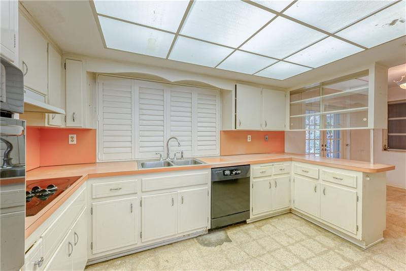 Large kitchen with plantation shutters