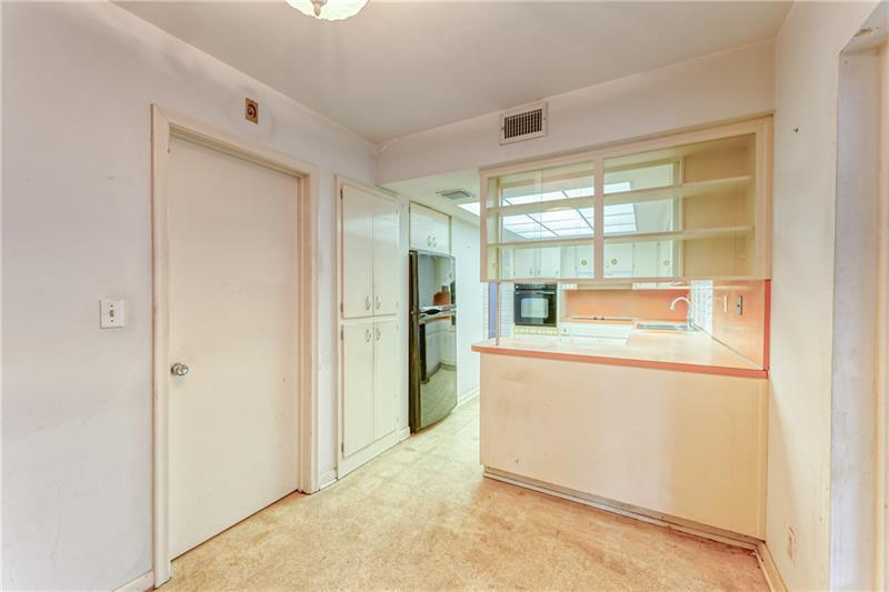 Large and spacious kitchen with tons of cabinets and glass cabinets