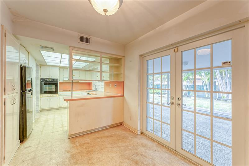 Large kitchen area with tile flooring