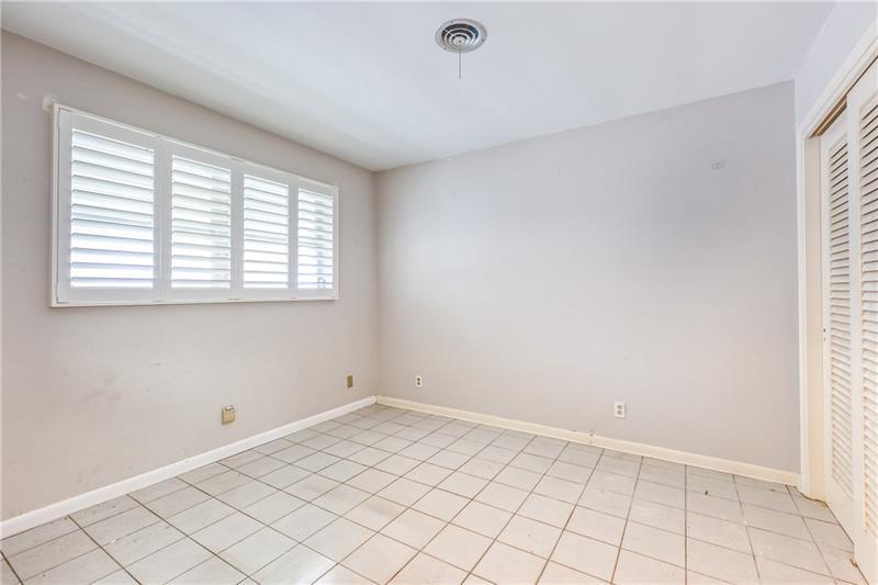 Tile flooring in bedroom