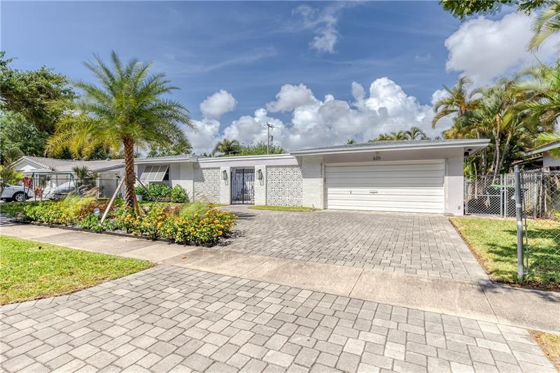 Great landscaping and large pavered driveway