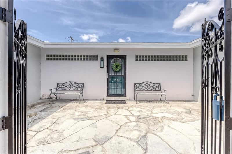 Large and spacious front gated courtyard