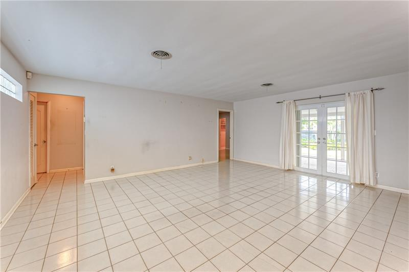 Large family room with French doors to backyard