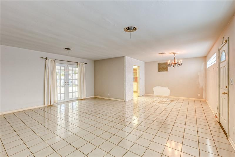 Family room / Dining room with tile flooring