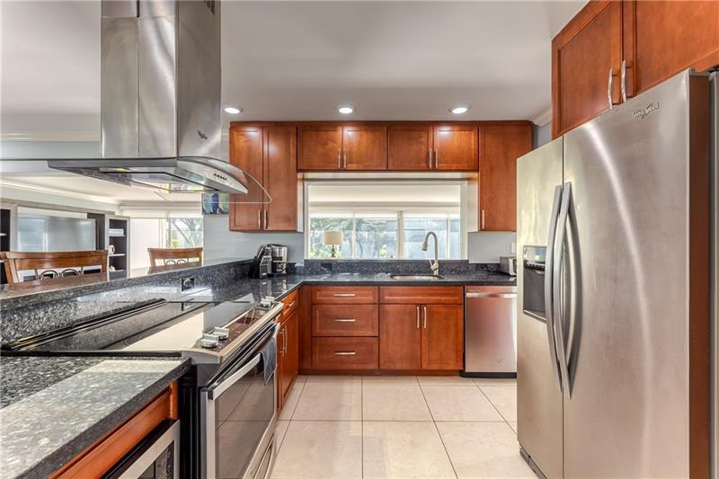 Stainless steel appliances and granite countertops in kitchen