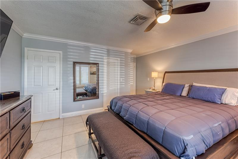 Master bedroom with ceiling fan with lighting