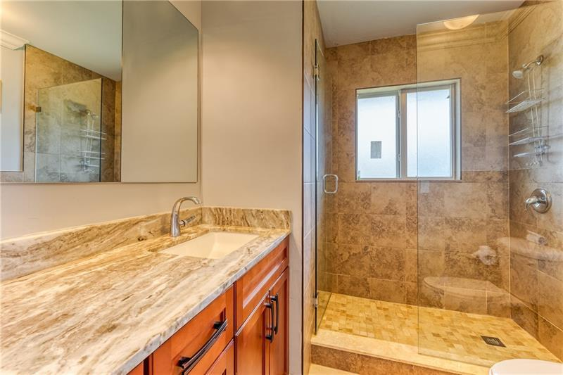 Second full bathroom offers large vanity and walk in shower