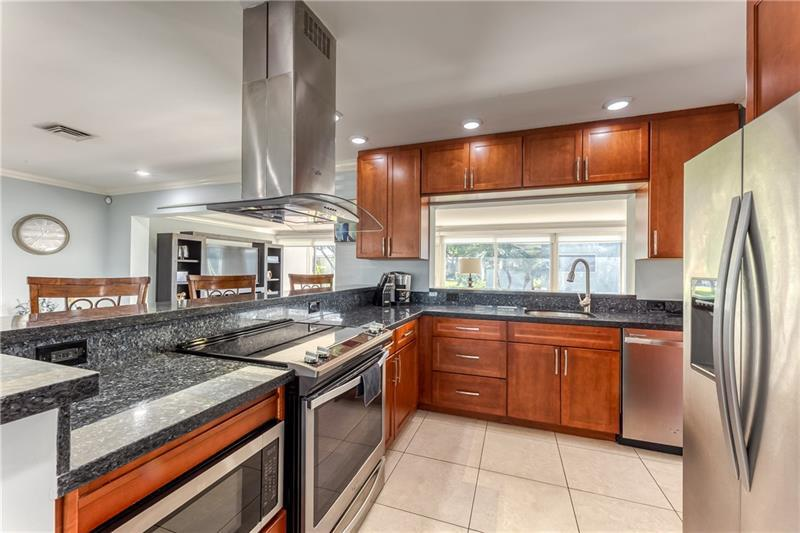 Open kitchen is renovated and the perfect space for entertaining