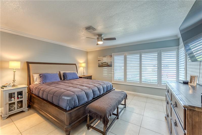 Master bedroom with tile flooring and tons of natural light