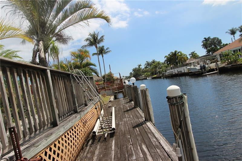 **** BOATERS PARADISE!!****GREAT FAMILY AREA, WATERFRONT, POOL, 3 BEDROOM 2 BATH HOME IN GREAT, FRIENDLY, ACTIVE AREA. CIRCULAR DRIVE, GARAGE, FAMILY ROOM, AND A PATIO. IF YOU ARE LOOKING FOR A HOUSE TO RE-BUILD OR UPDATE TO MAKE IT YOUR OWN THIS IS THE PERFECT HOUSE. DON'T MISS YOUR CHANCE TO MAKE THIS PROPERTY YOUR OWN!!!*****    ******************************** NO SHOWINGS UNTIL 04/13/2021*************************** *******  ALL OFFERS MUST BE CASH AND MUST BE ACCOMPANIED WITH PROOF OF FUNDS  ********