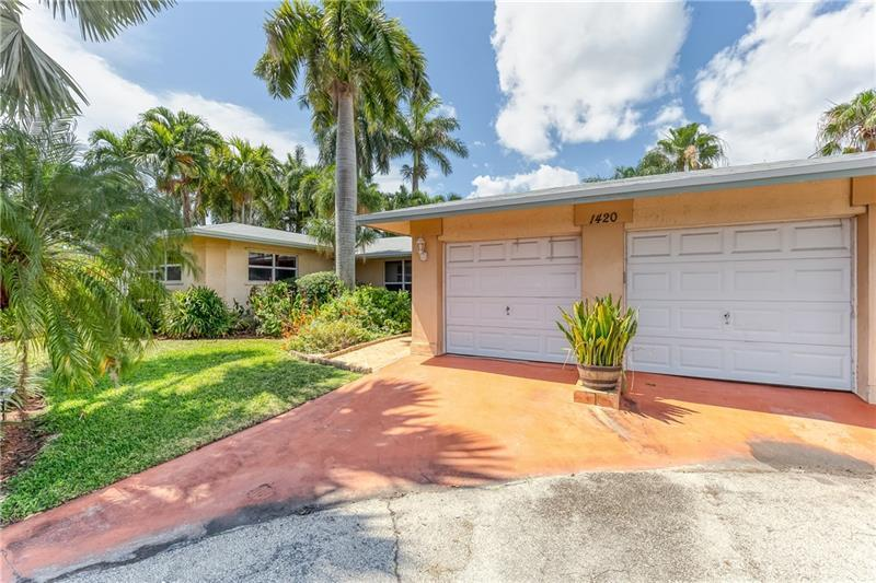 NE Wilton Manors waterfront house on the north fork of the Middle River - fixed bridges to the Intracoastal -- wonderful kayaking (or small craft) on the river.  Brand new roof this month (April 2021) !  Split bedroom floor plan with the large owner's suite on opposite side of the house, with french doors out to generous family room.  Tile flooring throughout the home.  Private pool surrounded by mature lush tropical landscaping.  Lots of private garden spots, gazebo, and covered deck on this 8,900+sf lot with 144' on the water.  Plenty of storage in the 2 car garage.