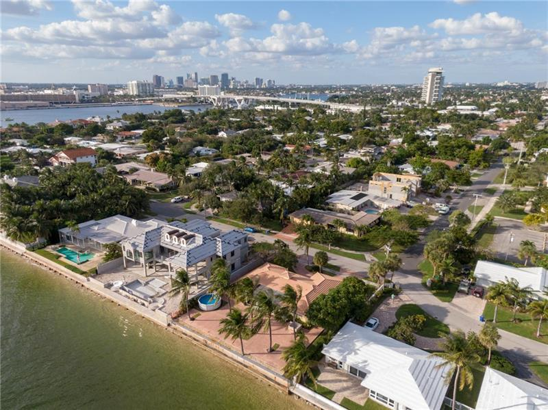 Enjoy the most unique & incredible views from this one of a kind location. Located on a 97x125 lot this well appointed single level home has direct views of the Ocean, the Inlet & Port Everglades. The home is in excellent condition to live in, rent out or you can capitalize on the opportunity to build your dream home. Featuring 3 beds/2 baths/2 car garage, large & open living area, split bedroom layout, well-appointed kitchen, indoor laundry, exposed beam ceilings & Hurricane Impact windows/doors! Entertain on the large patio & enjoy the parade of boats & most incredible sunrises & sunsets. If you are looking for that WOW location in a great neighborhood, look no further. You will talk about this view for a lifetime. All ages, no HOA, famil