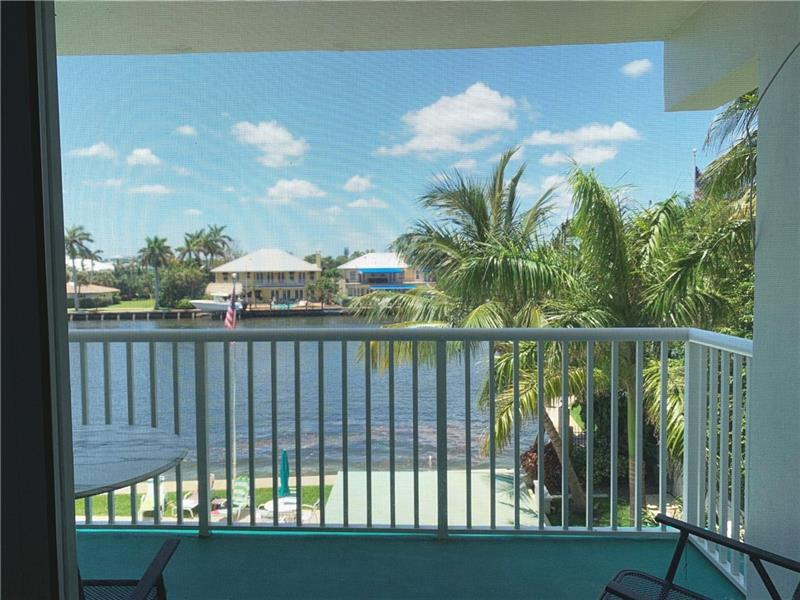 Enjoy incredible sunsets over the Intracoastal from your balcony in this spacious 2BR/2BA condo.  Spend the season or a year+.  You won't want to leave.  Only 2 blocks to the beautiful Deerfield beach.  Open kitchen, freshly painted, neutral tile throughout, impact windows and slider plus shutters.  A/C and HWH approximately 2 years old.  No pets. No Smoking.