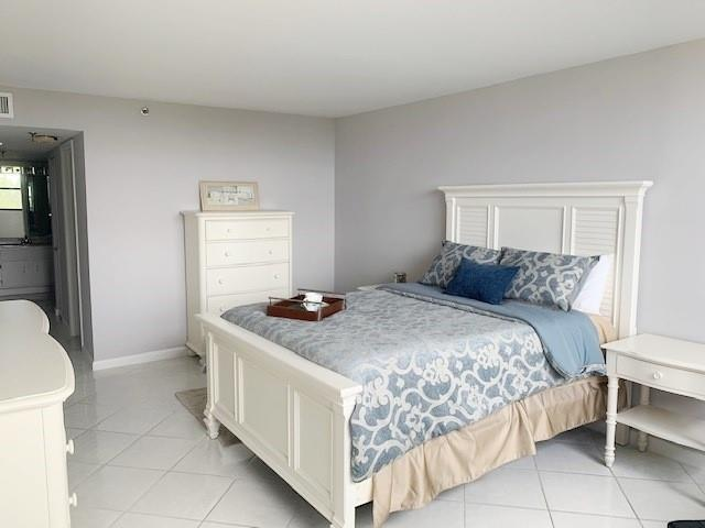 White tile floors throughout.  Over-sized Master bedroom