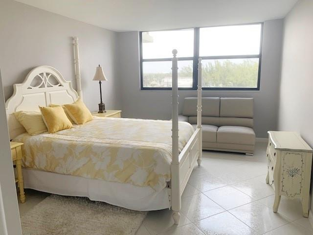Amazingly large guest bedroom with walk-in closet.  Tile floors throughout unit