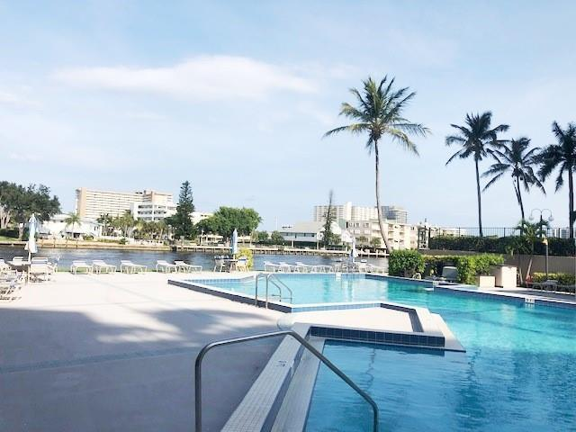 Resort heated pool at waters edge to watch a parade of boats daily