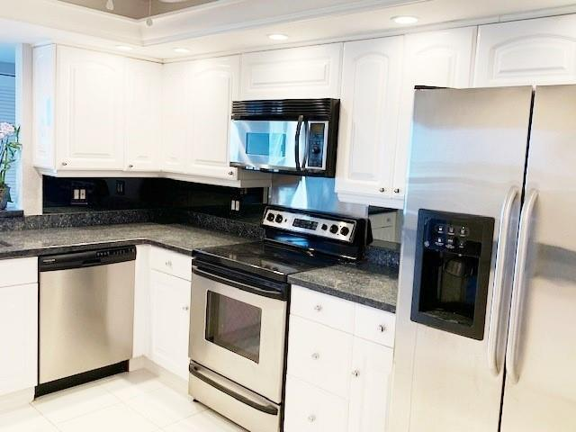 Upgraded kitchen with granite and stainless steel appliances.