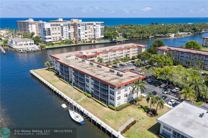 Location! Location! Location!  From the moment you step in this condo you are greeted with wonderful Intracoastal views.  This property is located in Lighthouse Point's Palm Aire Condo and features tree-lined streets and beautifully maintained buildings.  This large 2 bedroom 2 bath is in original condition and ready for a buyer's personal touches.  The kitchen has a small breakfast area and dining room and living room are spacious with direct Intracoastal views.  The master bedroom is large and has 2 closets including a walk in.  Enjoy the boat parade from your private screened patio. Enjoy the beautifully maintained community of Palm Aire featuring; boat dockage for rent (when available), pool, clubhouse, great parking, lots of open spac