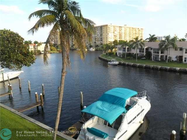 COMPLETELY RENOVATED TOWNHOME WITH PRIVATE BOAT SLIP INCLUDED. CAN ACCOMMODATE UP TO 34' BOAT ( ONE 12' FIXED BRIDGE) MINUTES TO ICW. INCREDIBLE VIEW OF THE BAY. WALL TO WALL SLIDERS IN LR AND MASTER BEDROOM. DOUBLE SCREENED BALCONIES. NEW LAMINATE FLOORING, CUSTOM GRANITE KITCHEN, WALK-IN CLOSETS, WASHER & DRYER AND STORAGE.  COMPLEX HAS TWO LIGHTED TENNIS COURTS, LARGE HEATED POOL, HOT TUB, SAUNA, FITNESS ROOM, TV AND WI-FI. TWO CAR PARKING WITH ONE SPACE COVERED AND ASSIGNED. 10 MINUTE DRIVE TO THE BEACH.  COMPLEX  HAS CAMERA SECURITY.  CLUBHOUSE HAS GENERATOR, WI-FI AND TV, FITNESS CENTER, SAUNA, KITCHEN. NO DARK TIME WITH POWER FAILURE . CLOSE TO SCHOOLS, HOSPITALS, SHOPPING AND I95 .  THIS IS PARADISE !