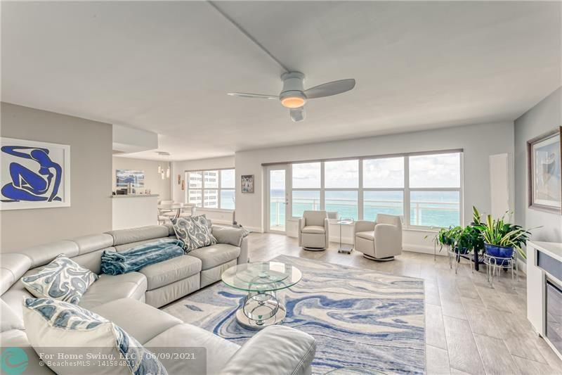Stunning absolutely gorgeous spacious (1821sf) 2 bed 2 bath OCEANFRONT condo directly on the sand. East west flow thru unit provides breathtaking DIRECT OCEAN, Intracoastal, sunrise and sunset views. IMPACT WINDOWS & DOORS, beautiful open GRANITE/STAINLESS-STEEL kitchen, new AC w/ UV light, new glass barn door to hide washer dryer, smooth ceilings, Porcelain tile floors, new interior glass paneled doors. Extra-large living and dining area, perfect for entertaining. Private Oversized master suite, large walk-in custom closet. Highly sought-after semi-private wing in the building with premier convenient garage parking spot. Pet friendly, 24/7 security, basic cable, 3 separate gyms, pool on the sand, reserves. Super market, shops, restaurants,