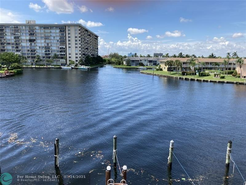 NEWLY FURNISHED, PAINTED,TWO CARS,TWO TENNIS COURTS,FREE PRIVATE DOCK INCLUDES WATER AND POWER, TOWNHOME IN CONDO GATED COMMUNITY WITH SUNDECK ROOFTOP OFF MASTER SUITE.  BEST VIEW OF BAY AND WATERWAY ENTRY INTO THE ICW. WASHER , DRYER, STORAGE PANTRY, BAR,TWO SCREENED BALCONIES, BEAUTIFULLY FURNISHED, RESORT STYLE COMPLEX, COVERED ASSIGNED PARKING, LIGHTED TENNIS, CLUBHOUSE WITH FITNESS, KITCHEN, ICE MAKER, INTERNET & WI-FI, GENERATOR, SHOWERS, SAUNA. GATE AND CAMERA SECURITY , HEATED POOL, HOT TUB, ONLY CONDO IN AREA OF WATERFRONT HOMES HOMES, LOCATED IN CUL-DE-SAC.  700 CREDIT SCORE, NO PETS.