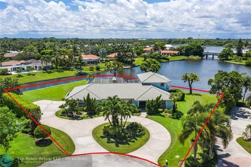 Once in a generation, this distinctive estate on the best street in Lake Ida welcomes a new family to enjoy a piece of Delray history and an active, outdoor lifestyle. With 325 ft of seawall-protected lake frontage on two sides of this half-acre property, and your own private dock just beyond the sunny south-facing pool, adventures on Lakes Eden and Ida will be a daily ritual. Walk the kids to Unity School at the end of the quiet, traffic-free cul-de-sac you share with seven stately homes, or to nearby Lake Ida Park, then hop on your bike or golf cart for a day at the beach or downtown before retreating to your spacious 4 bed/4 bath 4671 SF manse with its generous layout and plenty of room to expand or fully customize into your perfect drea