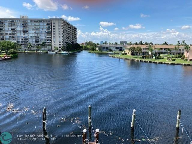 BOATERS DREAM COME TRUE WITH PRIVATE, ASSIGNED BOAT SLIP INCLUDED! CAN ACCOMMODATE UP TO 42'  WITH H20 & FPL INCLUDED. 20 MINUTES TO HILLSBORO INLET WITH SHORT BIKE RIDE TO THE BEACH. INCREDIBLE VIEWS OF THE BAY AS YOU ENTER. WALL TO WALL SLIDERS IN LR, & MASTER BEDROOM WITH DOUBLE SCREENED BALCONIES. NEW FLOORING, LAUNDRY, LIGHTED TENNIS COURTS, LARGE HEATED POOL & HOT TUB, SAUNA, FITNESS ROOM, TV AND WI-FI. 2 CAR PARKING-ONE  SPACE COVERED AT UNIT FRONT DOOR. COMPLEX GATED PLUS CAMERA SECURITY.  CLUBHOUSE HAS GENERATOR - NO DARK TIME WITH POWER FAILURE, WI-FI AND TV, FITNESS CENTER, SAUNA, KITCHEN. TIKI HUT WITH GAS BBQ AREA. CLOSE TO SCHOOLS, HOSPITALS, SHOPPING , I95 AND NEW RESTAURANTS ON THE BEACH. FREE BOAT SLIP, TWO CARS AND TWO PET