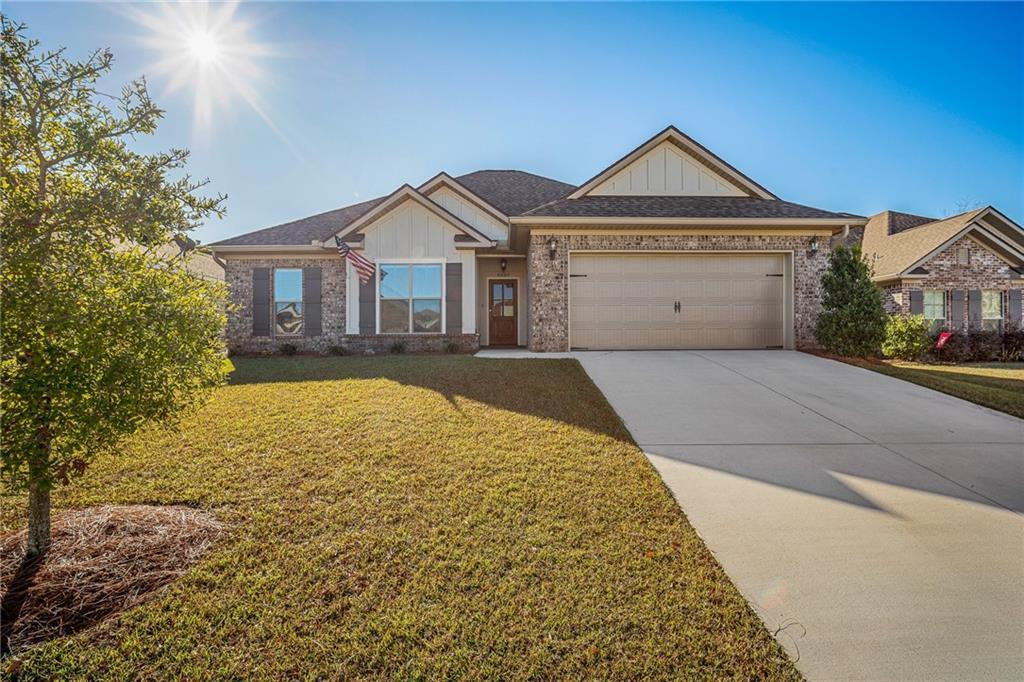 Almost new Truland home with open floor plan in French Settlement has 3 bedrooms/2 baths and just over 1,700 sq.ft. Beautiful hardwood floors start at the front door and continue through the living area and hallway while the kitchen and wet areas have large, neutral tile for easy cleaning. The family room is spacious with a corner gas log fireplace and large windows that allow lots of natural light to shine through. The kitchen has wood stained cabinets, a large center island with granite & a breakfast bar. Large eat-in kitchen has a great view of the fenced backyard - complete with covered patio, pergola and fire pit for a great entertaining space. This home also includes a nice size master bedroom with trey ceiling and an en-suite that co