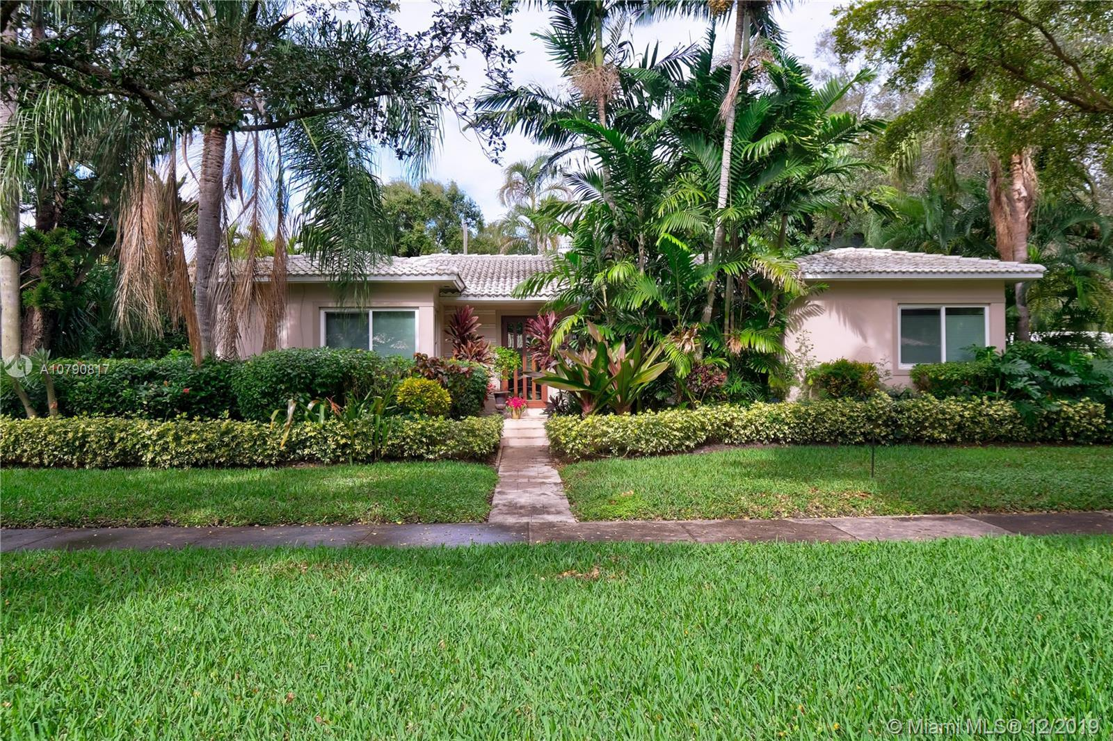 MIAMI SHORES GEM LOCATED ON QUIET CORNER LOT. MANY RECENT UPDATES INCLUDE NEW TILE ROOF AND NEW IMPA
