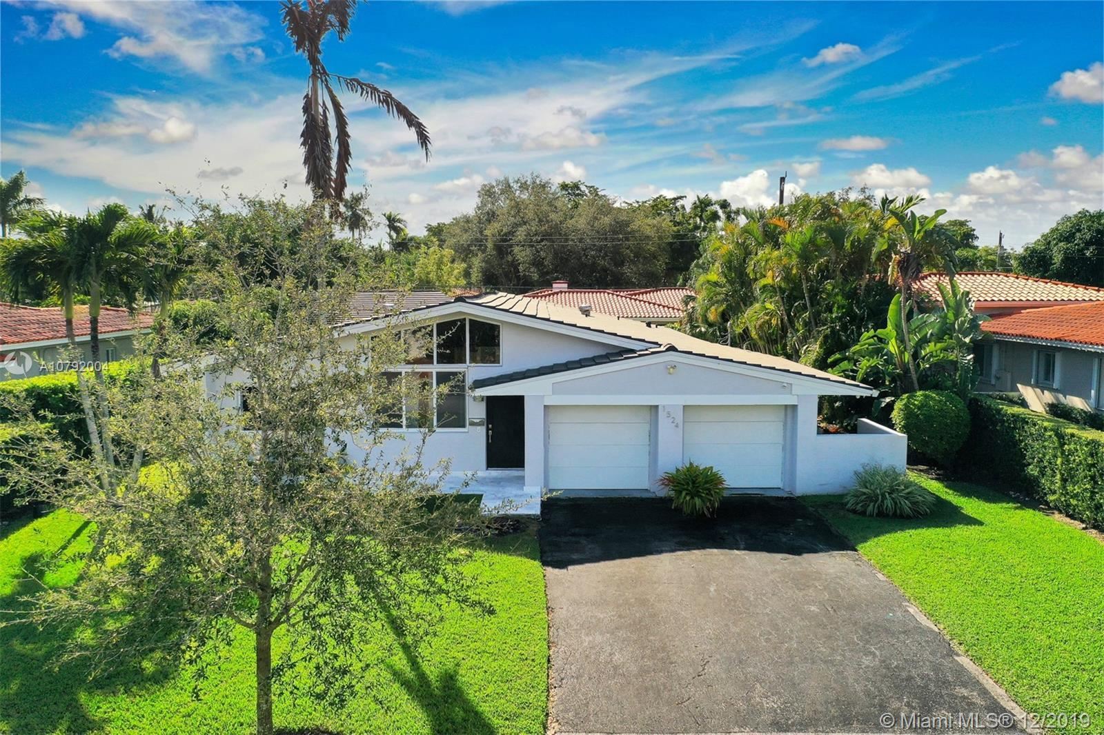 Charming Mid-Century home. This home features 3 bedrooms /3 baths and a floor plan that is fluid and