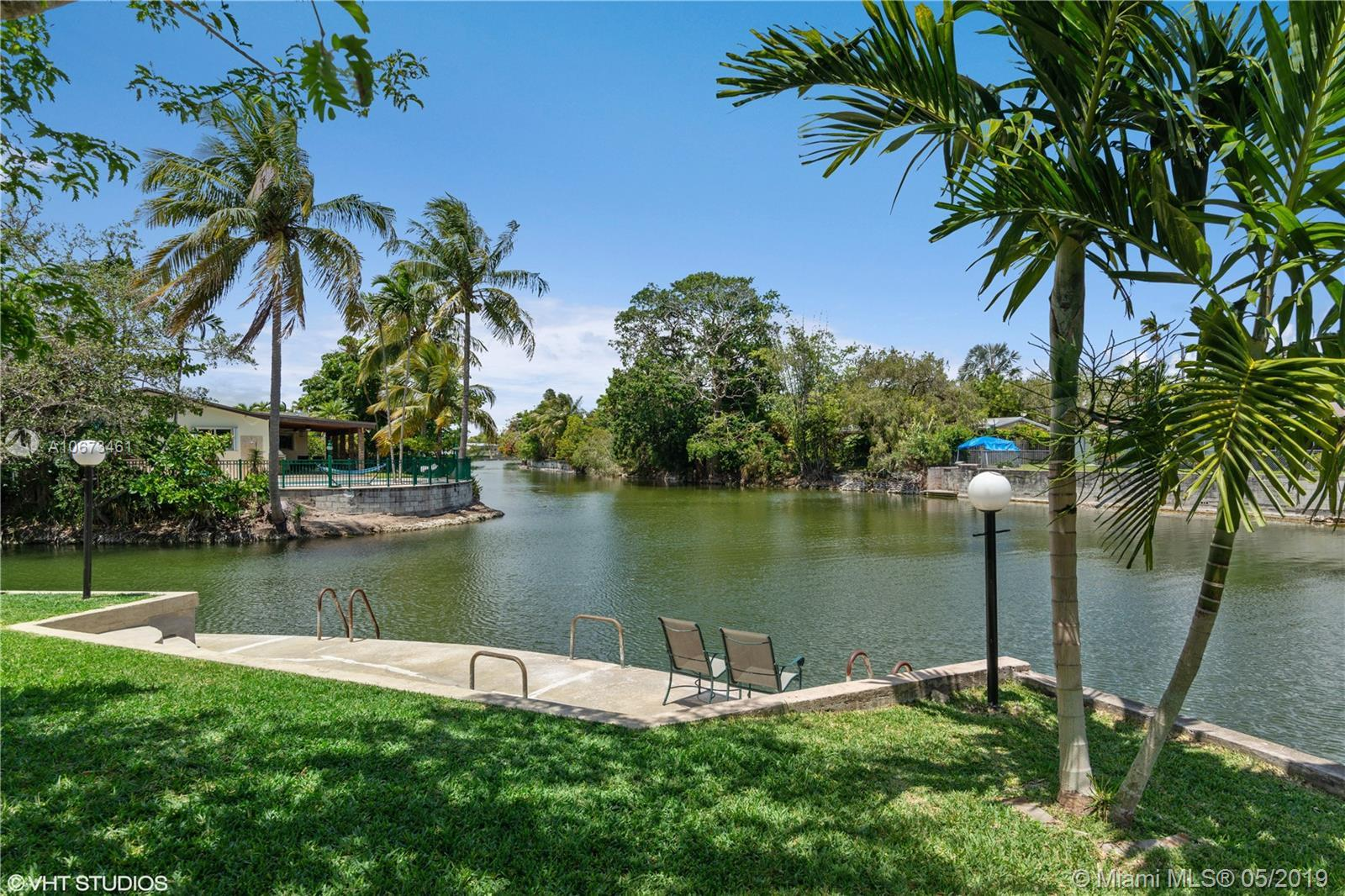 On the fabulous Twin Lakes, in the heart of South Miami, this very unique corner lakefront property