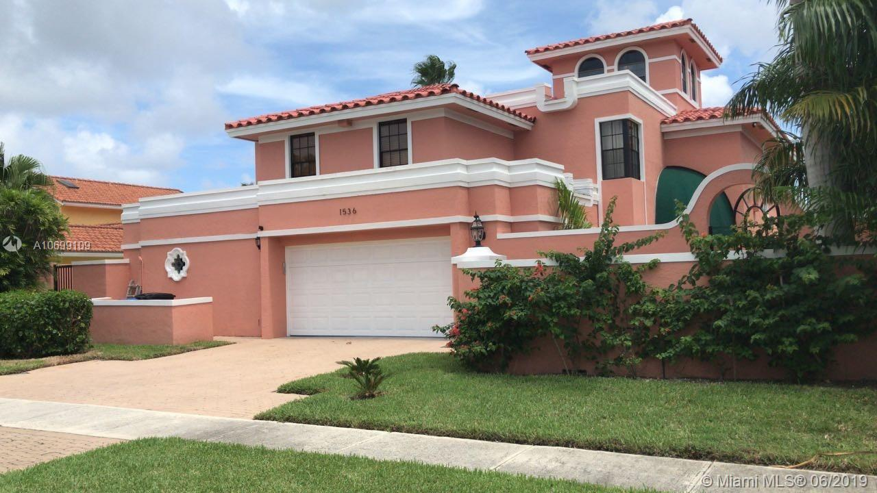 NEAR MIZNER PARK,MEDITERRANEAN STYLE HOME WITH OCEAN ACCESS ON 75 FT OF WATER 67FT DOCK LOCATED IN A