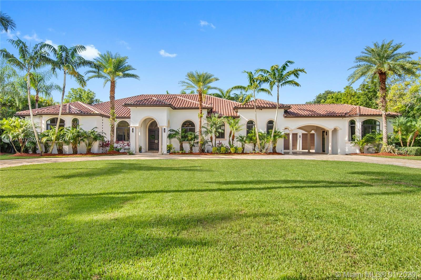 Majestic Residence located in North Pinecrest! Gated 46K SF lot on a tranquil street, 7450 SW 100th