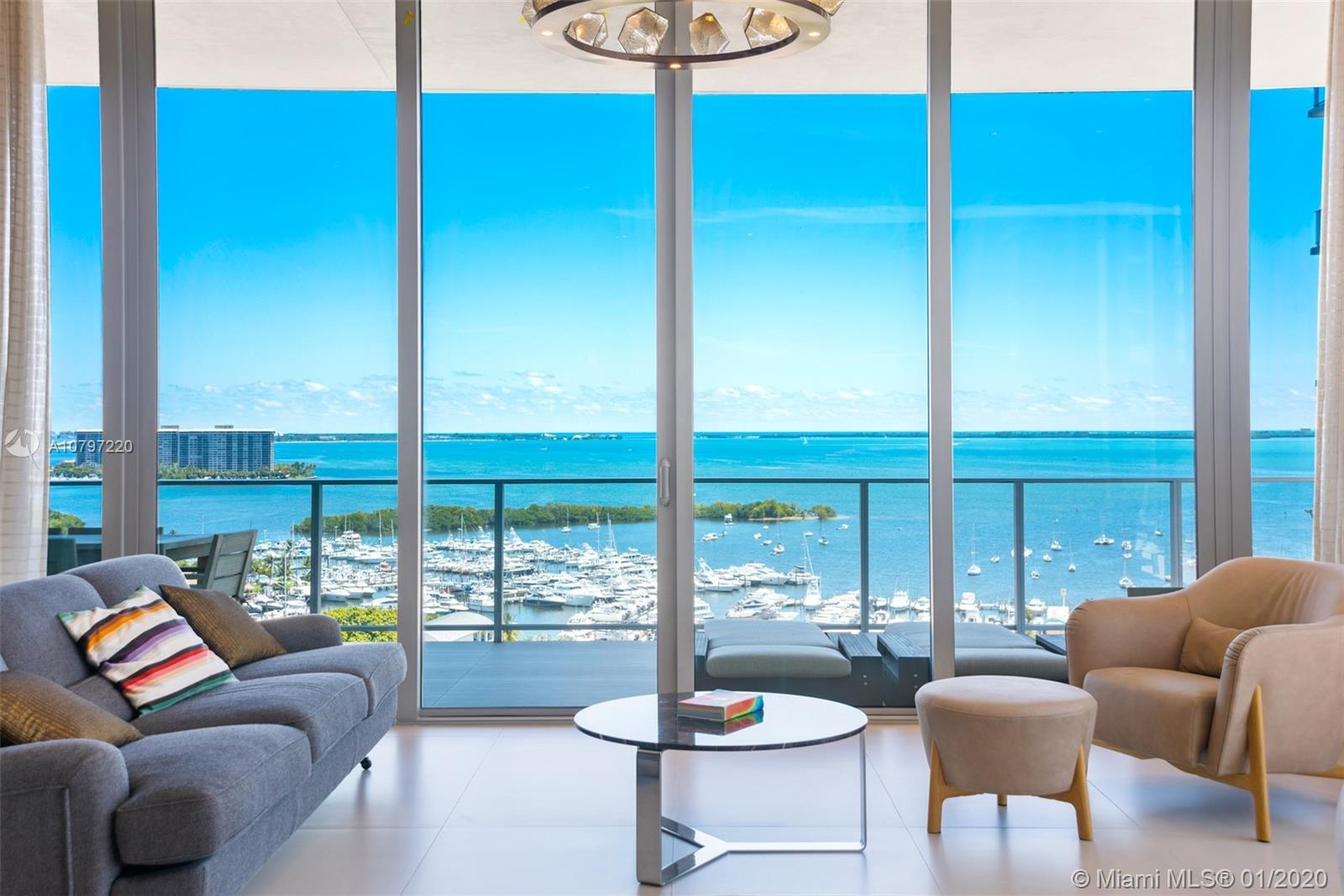 Enjoy amazing panoramic views of the city and Biscayne Bay throughout 12-foot floor to ceiling glass