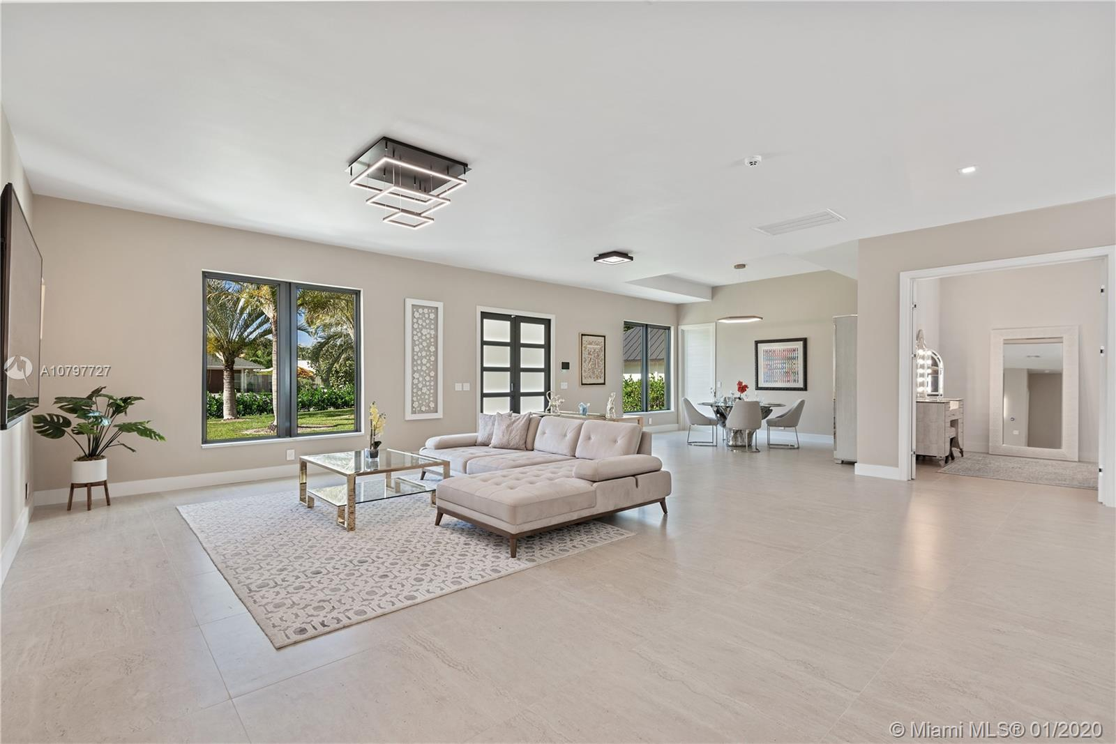 Modern and spacious 4-bedroom home decorated with warm, natural tones.  10-12 Ft. Ceilings throughou