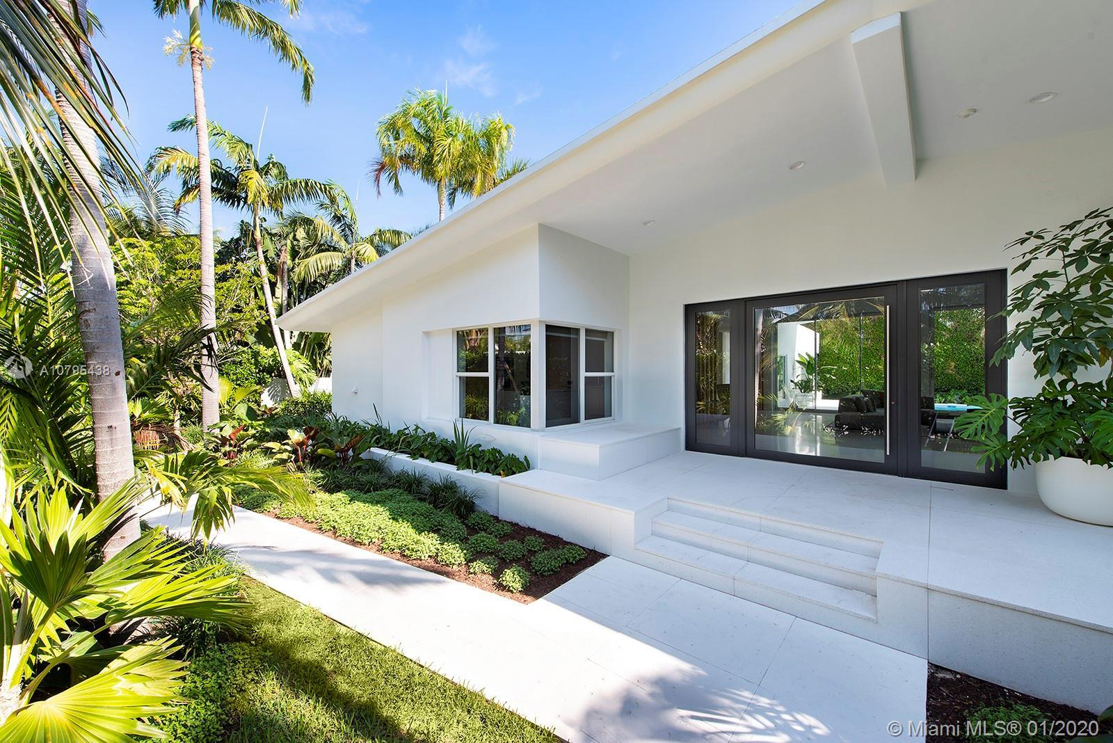 Located on the coveted Venetian Islands, this 5 bedroom 5.5 bath Mid-Century Modern home sits on an