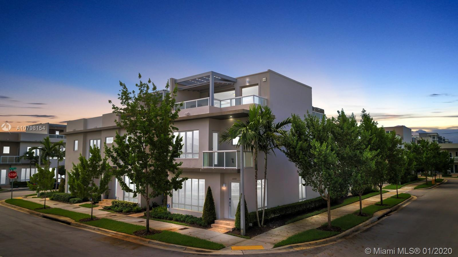 Spectacular and luxurious three-story 4 bedrooms 3 and a half bathrooms townhome plus a NEXTGEN with