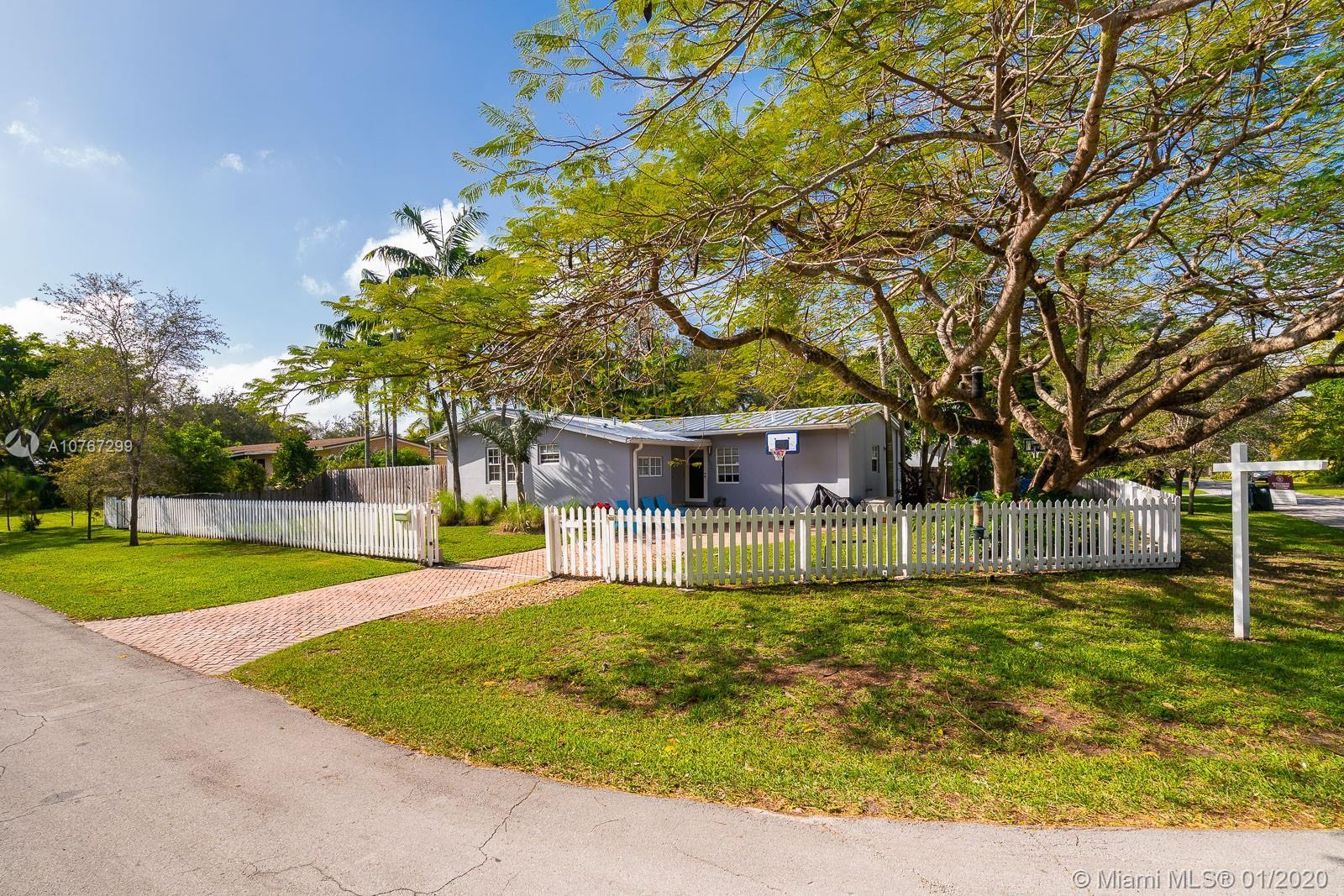 Adorable, white picket fenced family-sized home in the heart of SoMi located on a quiet, tree lined