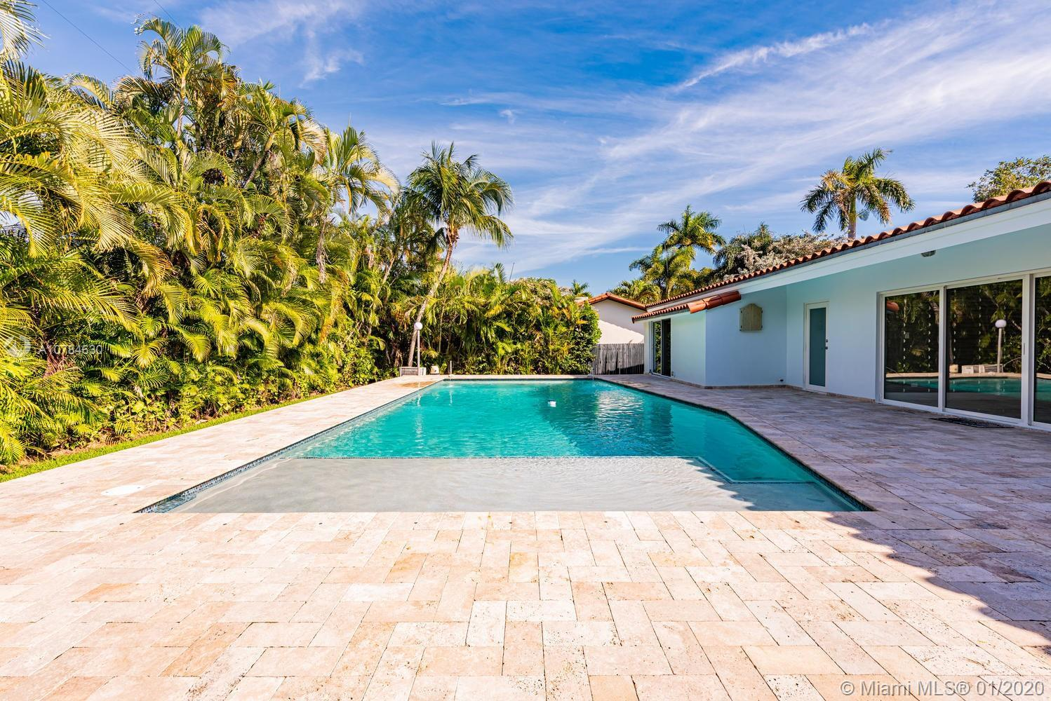 Spectacular 4/3 pool home steps to Biscayne Bay Entertain galore in this beautiful home.Foyer entran