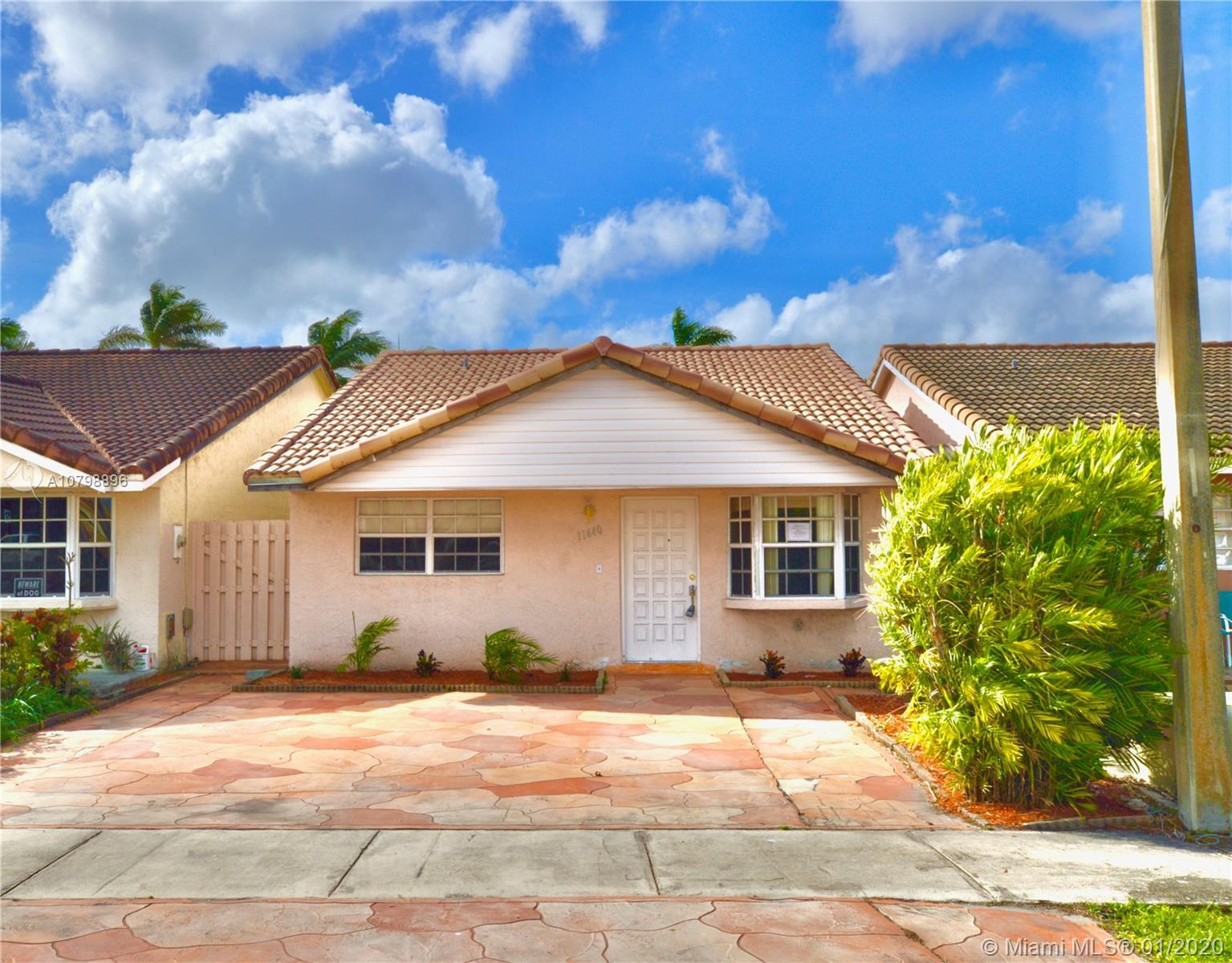 Cozy West Hialeah bedroom, 2 bathroom home. Newer roof, tiled throughout with a covered patio in the