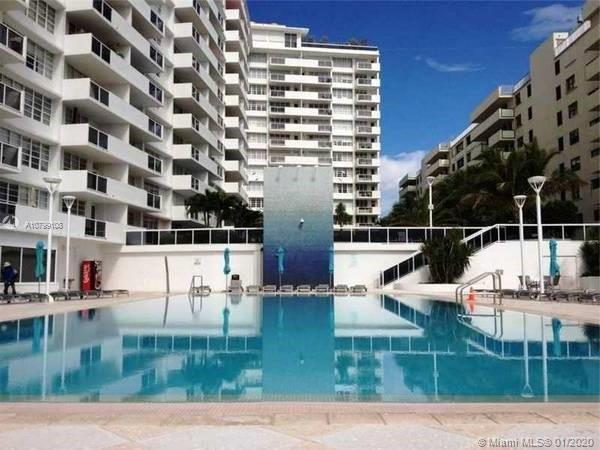 Spacious studio with direct water view and access. Bright unit facing the water beach and pool  Tile