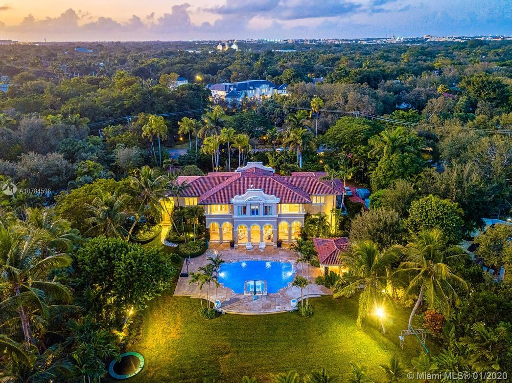On a 45,738 SF lakefront lot sits a stunning 8909 SF Mediterranean-type home. This special home is l