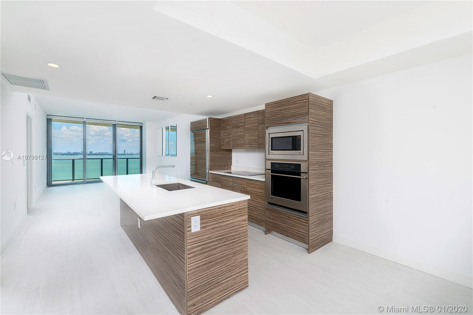 Enjoy unobstructed bay views from this beautiful residence. Featuring 2 bedrooms, 2 baths plus den,