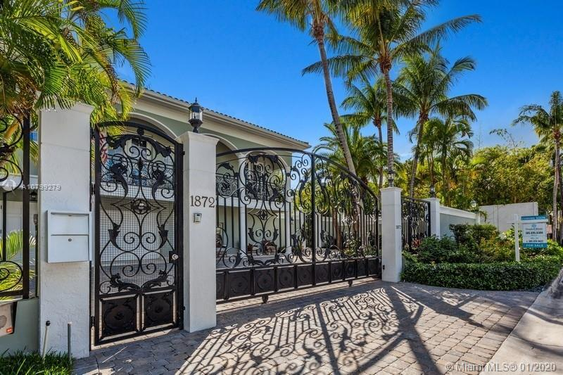 This spectacular, two story waterfront Villa features breathtaking views of Biscayne Bay and offers