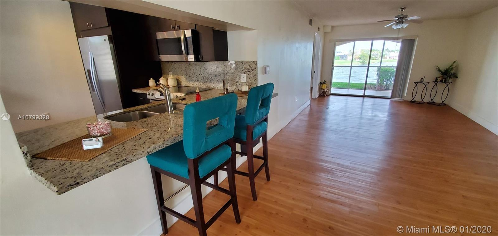 Gorgeous 2 beds & 2 baths first-floor apartment. Remodeled, laminated wood floors, screen patio, mod