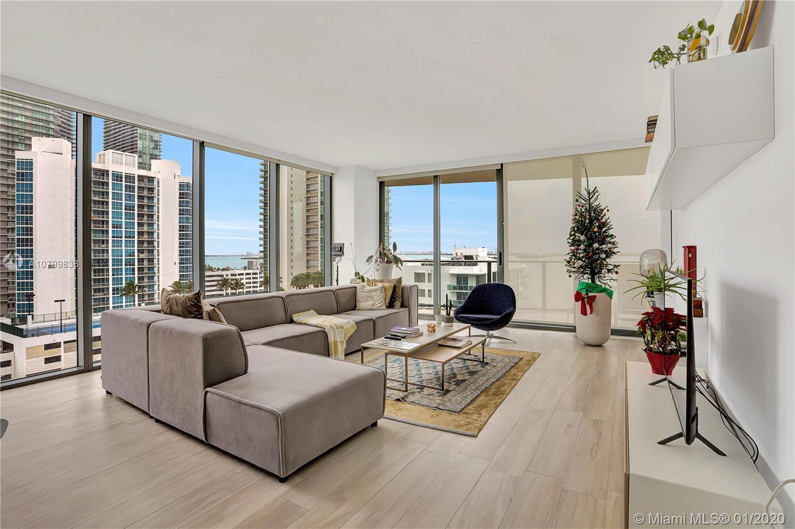Stunning corner unit at the desirable Icon Bay with spectacular city and bay views. This furnished 2